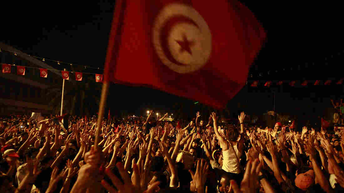 People gather outside the Constituent Assembly headquarters during a protest to demand the ouster of the Islamist-dominated government, in Tunis, Tunisia, on July 28.