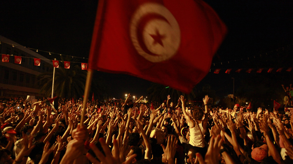 People gather outside the Constituent Assembly headquarters during a protest to demand the ouster of the Islamist-dominated government, in Tunis, Tunisia, on July 28. (Reuters/Landov)