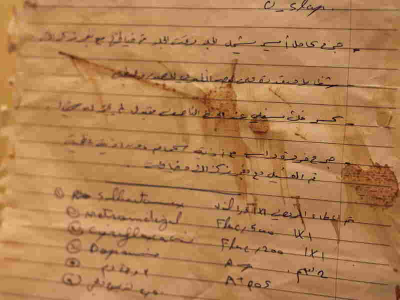 A wounded Syrian who arrived in Israel brought this referral letter, written on a bloodstained piece of notebook paper, from a Syrian doctor explaining the patient's injuries.