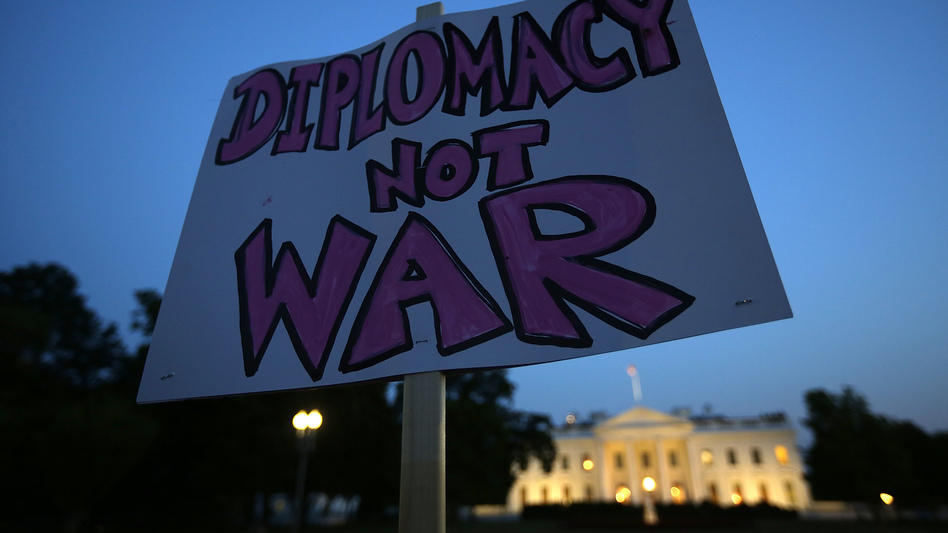 Protesters gather outside the White House on Tuesday before President Obama addressed the nation about the situation in Syria. Obama said he was asking Congress to delay authorizing a strike on Syria to allow a diplomatic plan to work.