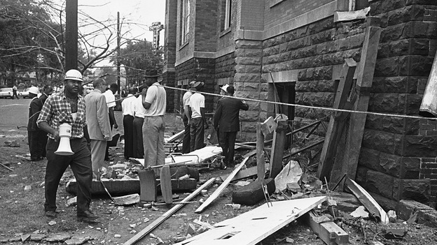 Investigators work outside the 16th Street Baptist Church in Birmingham, Ala., following an explosion that killed four young girls. Three Ku Klux Klansmen were convicted in the bombing years later. (AP)