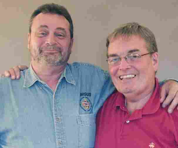 Rich Barham, left, and Nelson Peck are both veterans working for the Veterans Crisis Line.