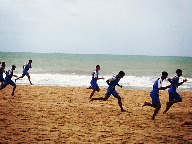 An under-20 soccer team trains on the beach in Recife, Brazil.