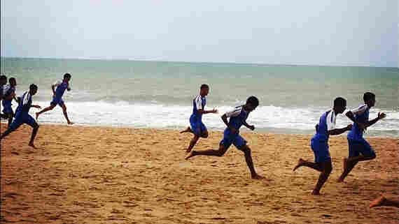 An under-20 soccer team trains on the beach in Recife, Brazil.