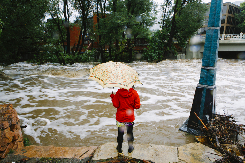 Boulder Creek flooded early Thursday after three days of heavy rainfall. An estimated 6-10 inches of rain fell in 12-18 hours, and more is expected throughout the day. Flash flood sirens warned people to stay away from Boulder Creek and seek higher ground. (Getty Images)