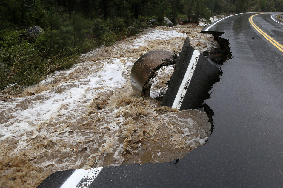 A section of Highway 72 is missing after a flash flood tore through Coal Creek near Golden, Colo., on Thursday.  (Reuters/Landov)