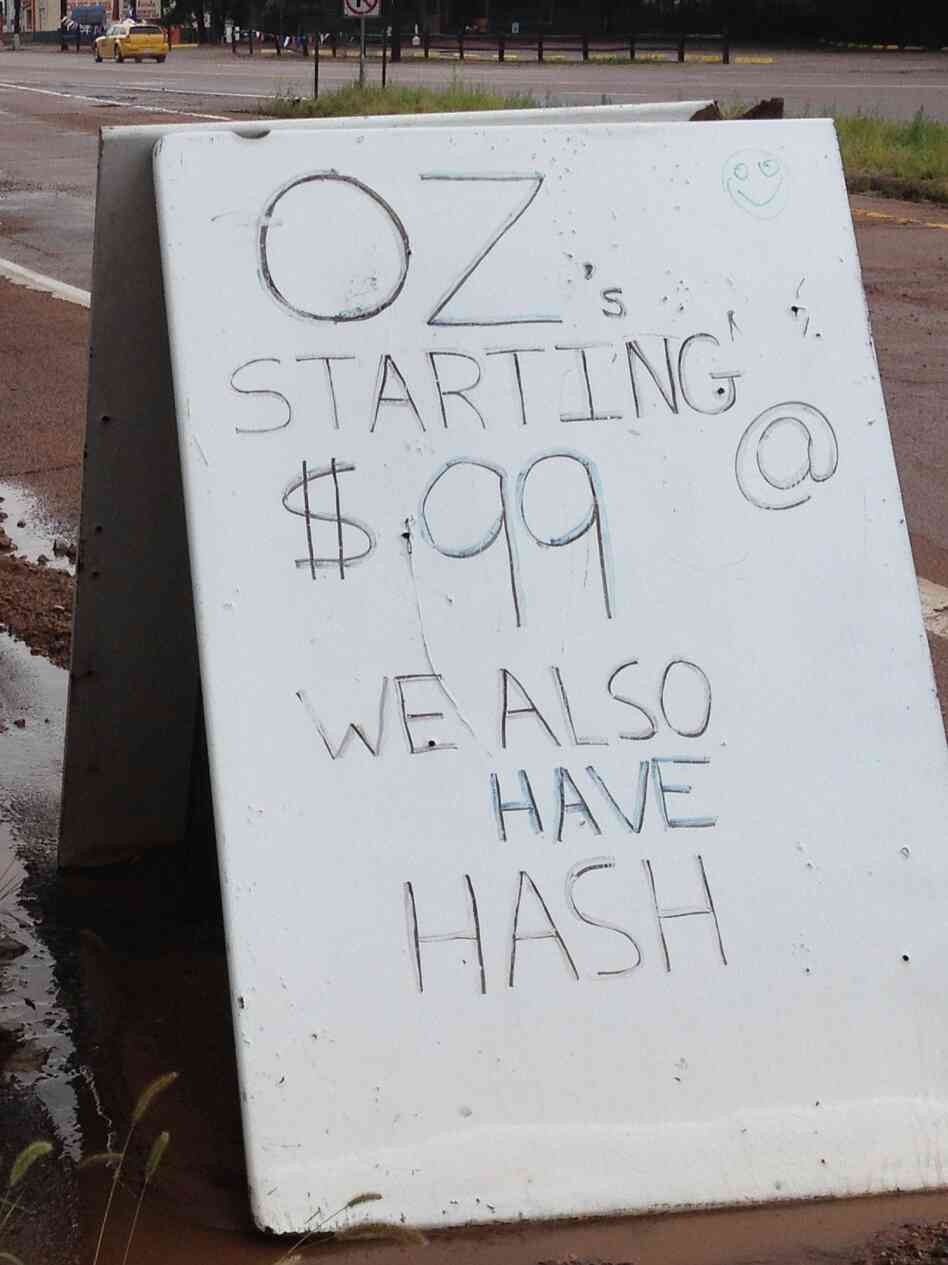 A sign outside a medical marijuana dispensary in Manitou Springs, Colo. Voters amended the state's constitution to legalize marijuana for recreational use in November 2012.