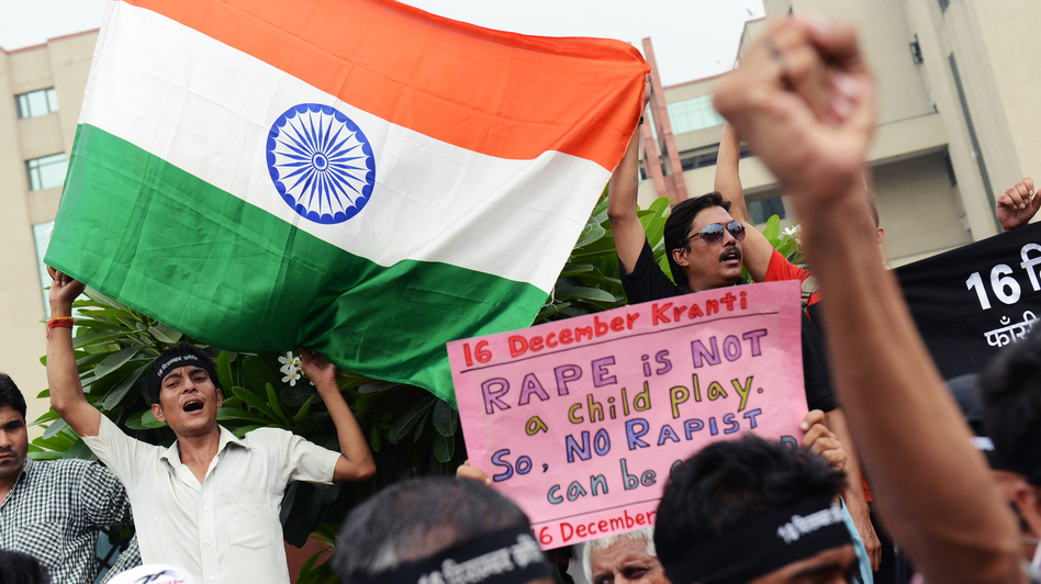 Outside the courthouse in New Delhi on Friday, demonstrators gathered to call for — and then celebrate — the death sentences handed down for four men convicted in the December gang rape and murder of a young woman. (AFP/Getty Images)