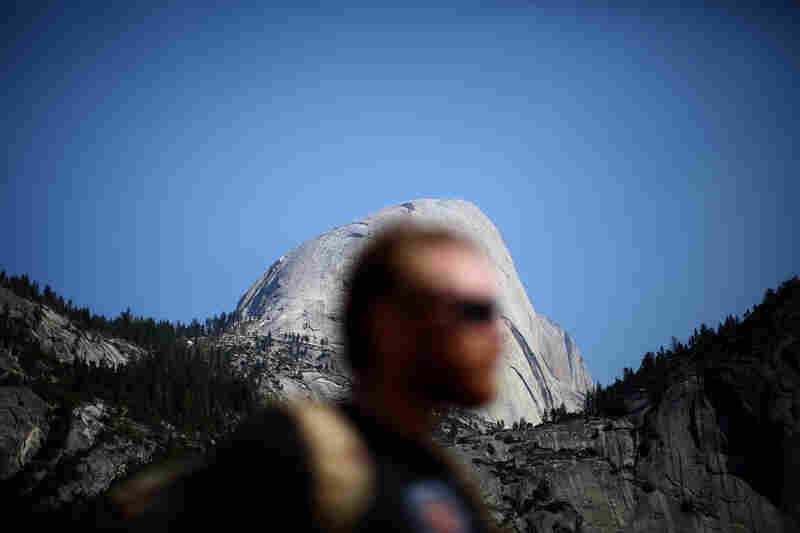 Sullens, who lost his leg while serving with the Army in Afghanistan, stands in front of the Half Dome rock formation in Yosemite Valley, Calif. Military veterans, with the adaptive rock-climbing group Paradox Sports, climbed two of Yosemite National Park's signature peaks to mark the Sept. 11 anniversary.