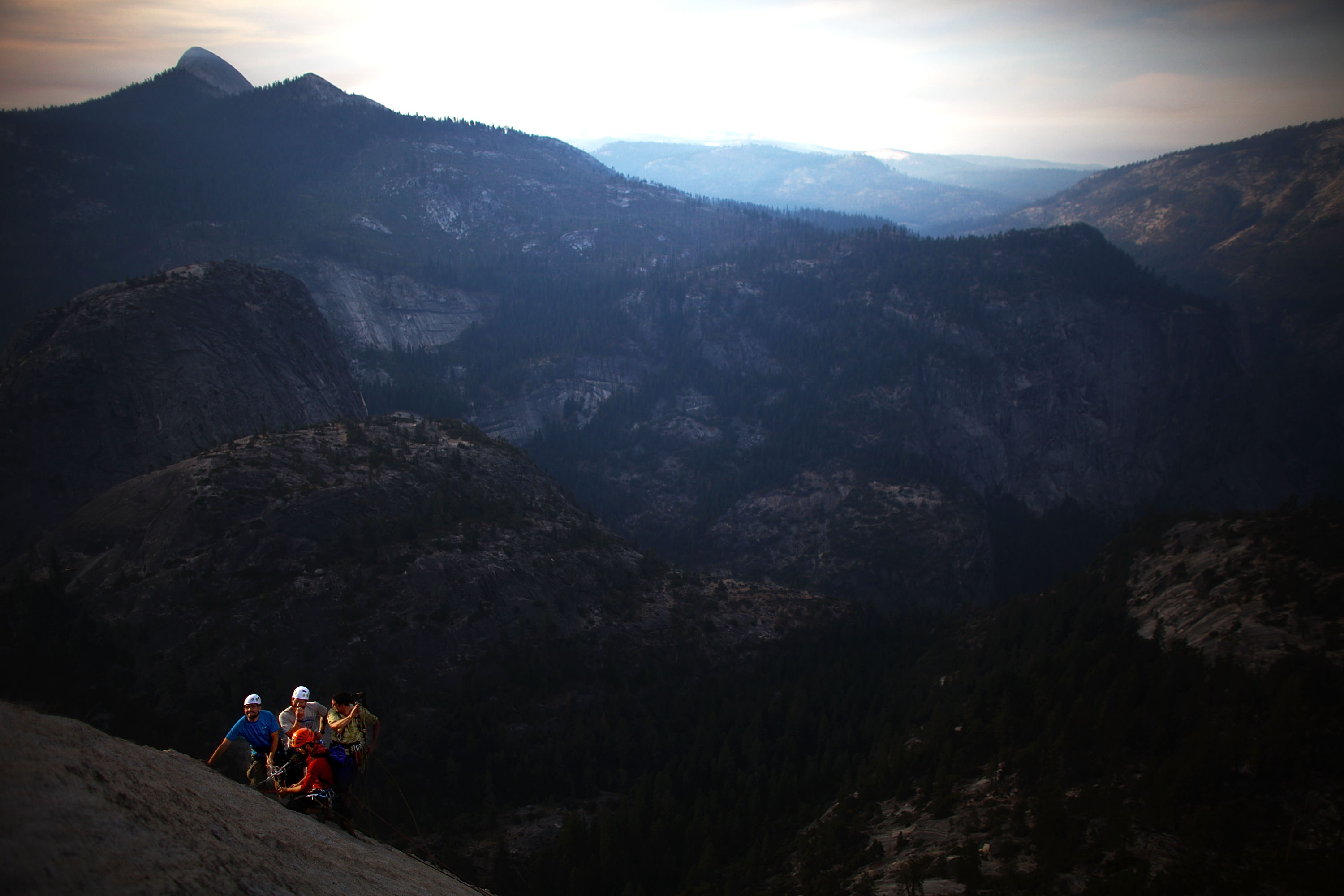 "Veterans Andrew Sullens and Nate Watson scale the western wall of Half Dome with help from Tim ""Timmy"" O'Neill, co-founder of Paradox Sports, and volunteer Pat Warren."