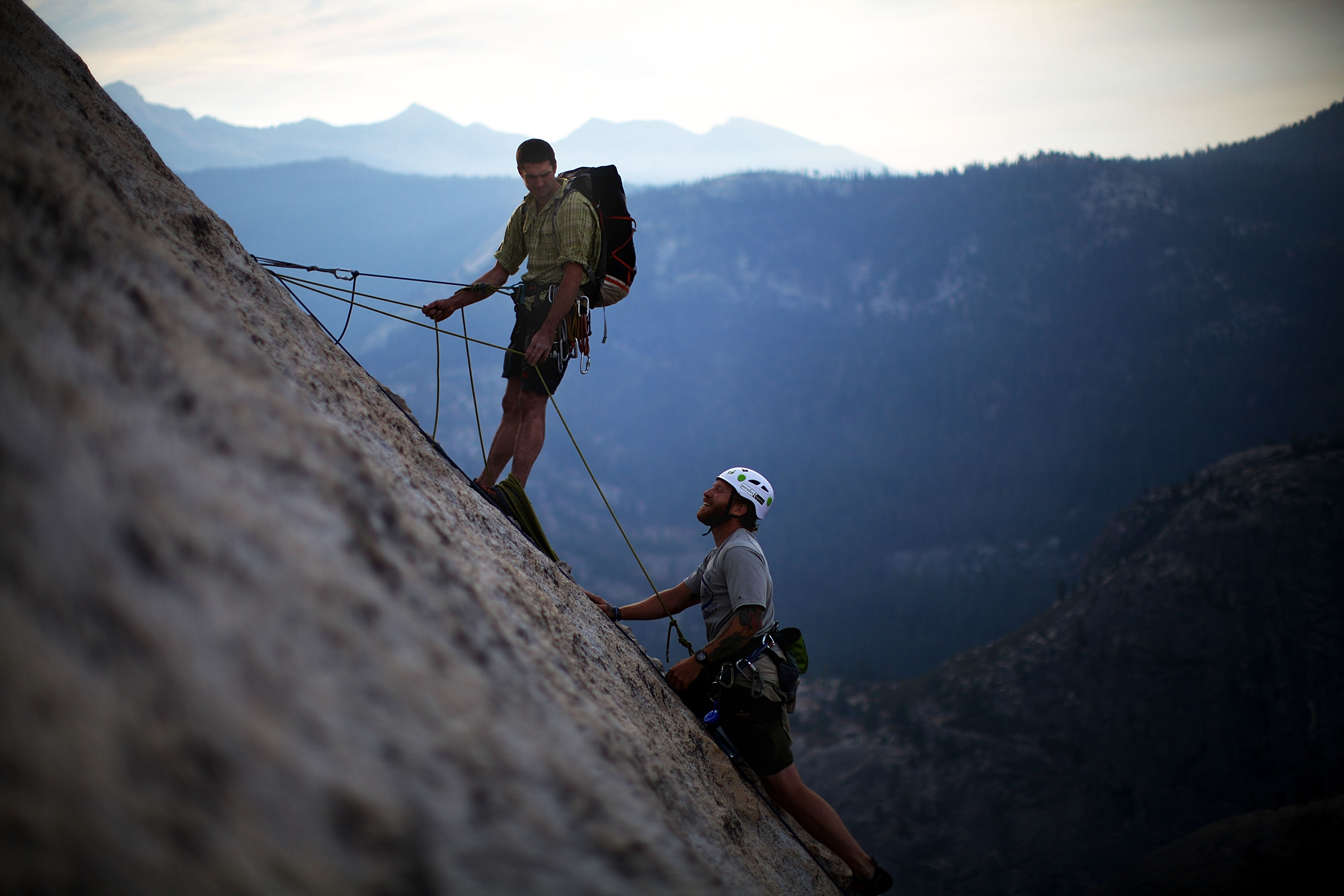 "Using a prosthetic leg, Sullens (right) climbs the ""Snake Dike"" on the western face of Half Dome, while Warren belays him."