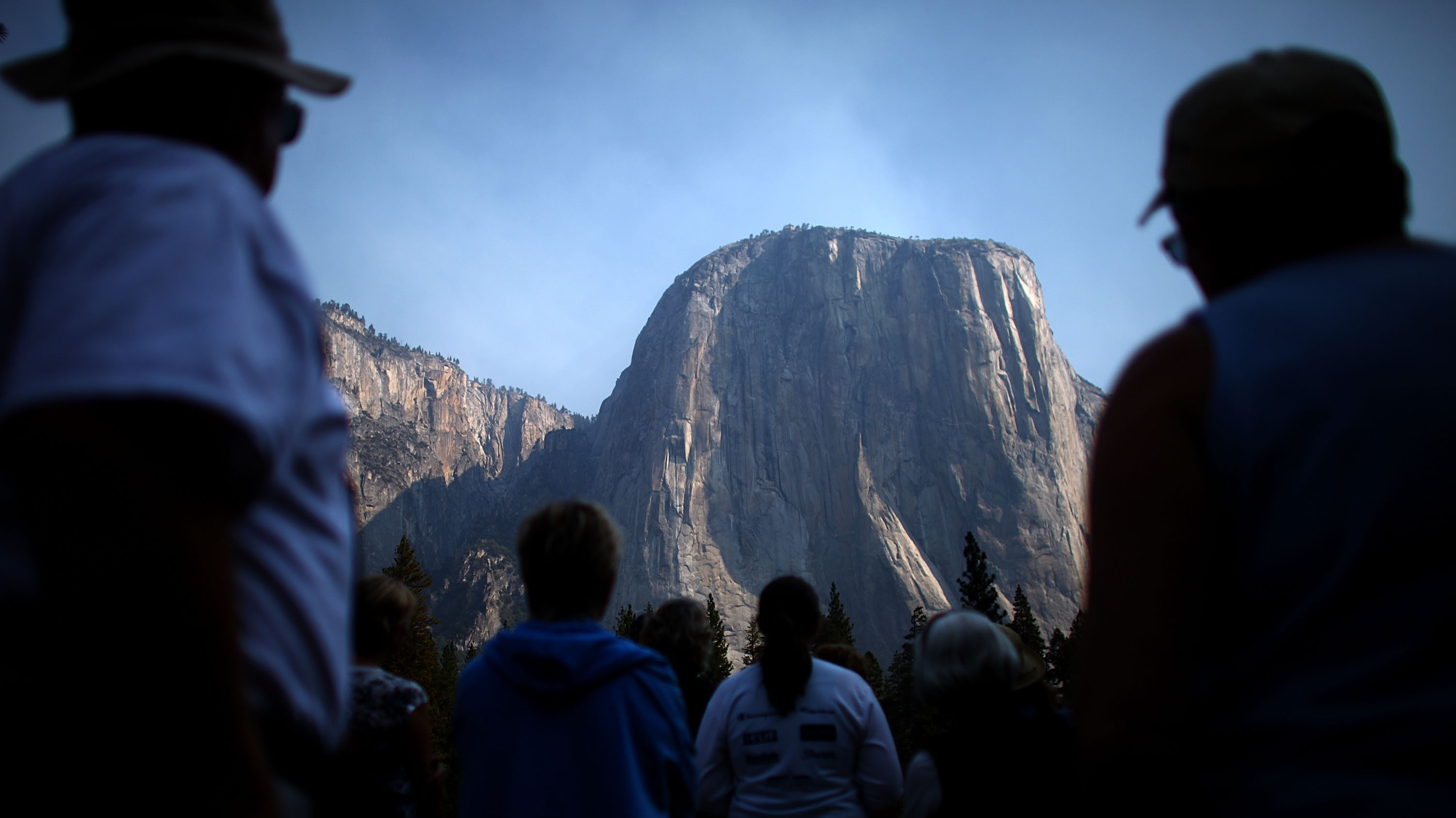 Tourists look up at the world famous El Capitan in Yosemite National Park. Military veterans with the adaptive rock-climbing group Paradox Sports summited two peaks in the park to mark the September 11th anniversary: El Captain and Half Dome.