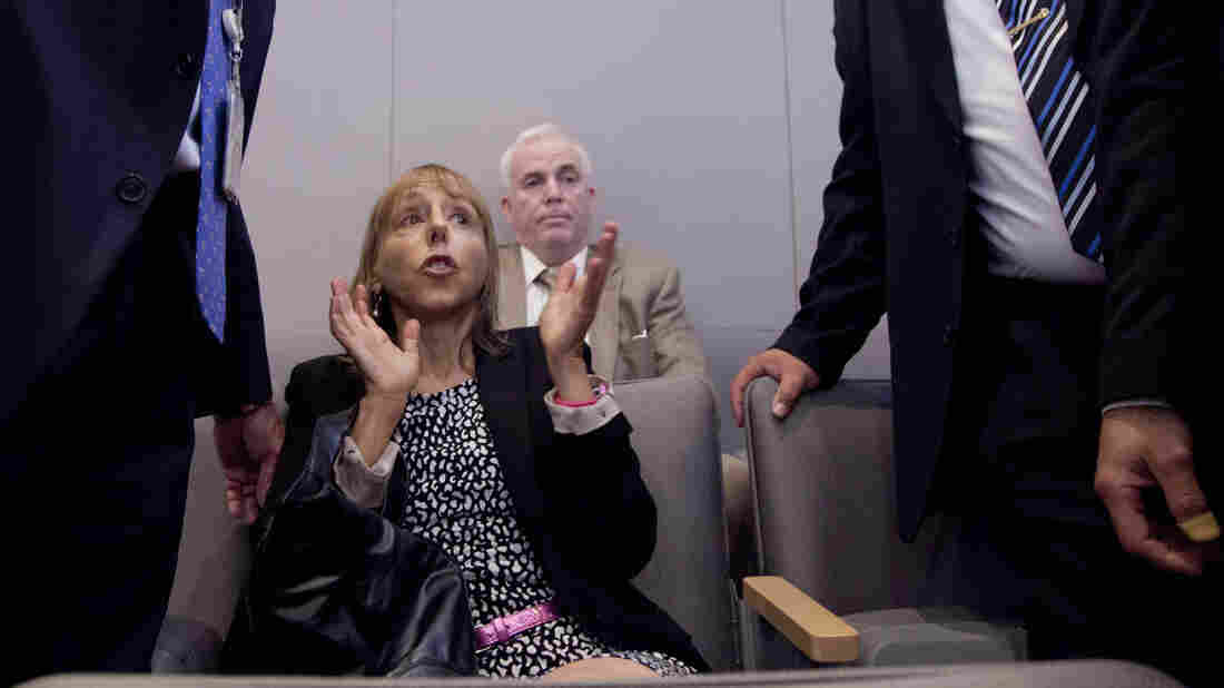 Code Pink founder Medea Benjamin is surrounded by security as she shouts at President Obama during his speech at the National Defense University in May.