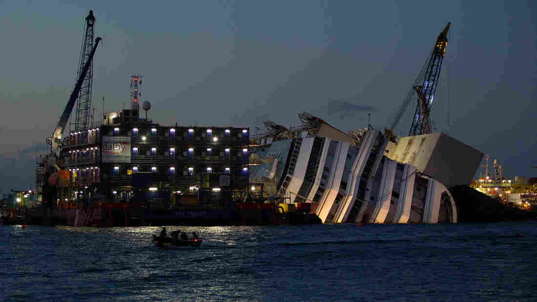 Work at the wreckage of the Costa Concordia continues through the night Sept. 14, off the Italian island of Giglio. The Costa Concordia is due to be righted, in a project set to begin Monday.