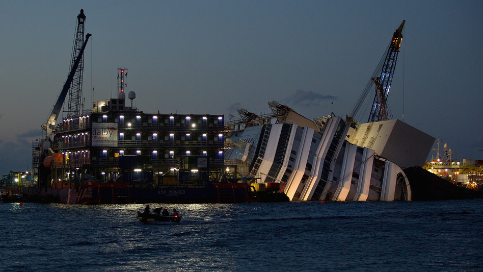 Work at the wreckage of the Costa Concordia continues through the night Sept. 14, off the Italian island of Giglio. The Costa Concordia is due to be righted, in a project set to begin Monday. (Getty Images)