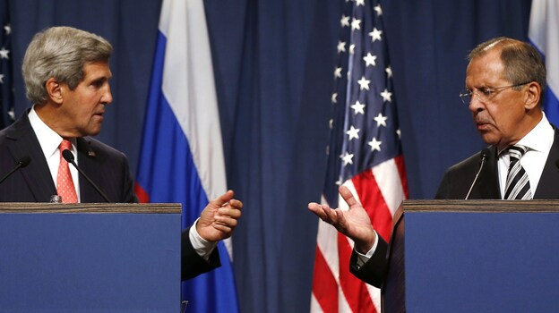 Secretary of State John Kerry and Russian Foreign Minister Sergei Lavrov announced a plan to eliminate Syria's chemical weapons arsenal from Geneva on Saturday. (AFP/Getty Images)