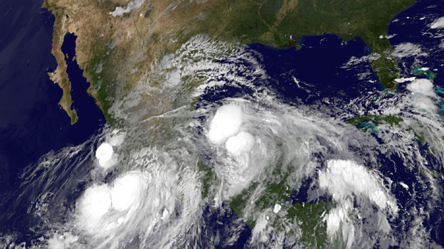 An image provided by NOAA taken at 2:45 a.m. EDT Sunday shows Hurricane Ingrid approaching from the Gulf of Mexico and Tropical Storm Manuel just off the western coast of Mexico. (AP)