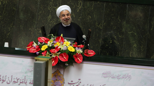 Iran's President Hasan Rowhani, who was elected in June, has exchanged lettes with President Obama, the U.S. leader said in an interview that aired Sunday. Here, Rowhani speaks to Iran's Parliament in Tehran. (AFP/Getty Images)