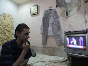 The Syrian regime calls a new deal on its chemical weapons a victory, in a reaction that came one day after the U.S. and Russia announced the plan. On Saturday, live coverage of the the deal drew the attention of a Damascus flower shop owner.