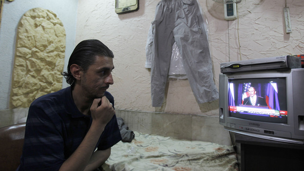 The Syrian regime calls a new deal on its chemical weapons a victory, in a reaction that came one day after the U.S. and Russia announced the plan. On Saturday, live coverage of the the deal drew the attention of a Damascus flower shop owner. (AFP/Getty Images)