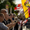 NPD Party activists hold up German flags in the Hellersdorf-Marzahn district of Berlin last month, as they protest a new home for asylum seekers.