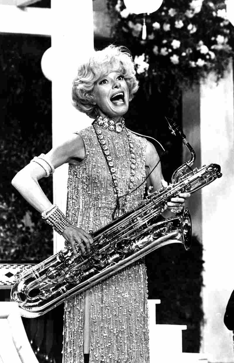 Channing sings and plays the bass saxophone during a rehearsal for the movie Thoroughly Modern Millie in 1966.