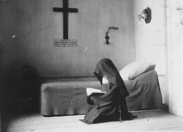 A Carmelite nun in her cell in France in 1904.