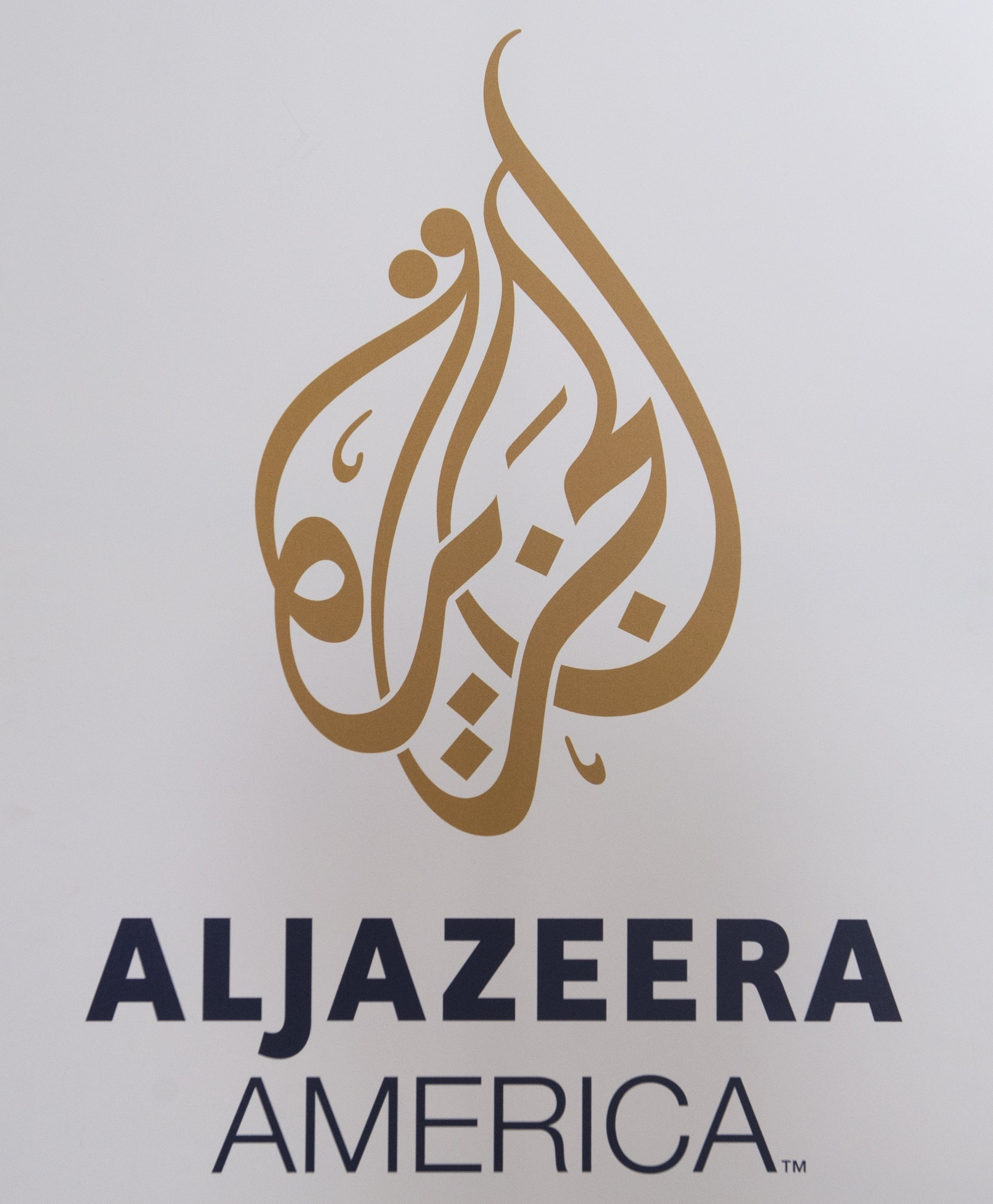 The logo for the cable news network Al Jazeera America appears outside the network's studio space at the Newseum in Washington, D.C.