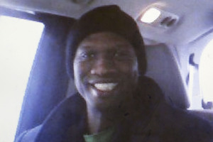 This undated cell phone photo provided shows a smiling Aaron Alexis in Fort Worth, Texas.