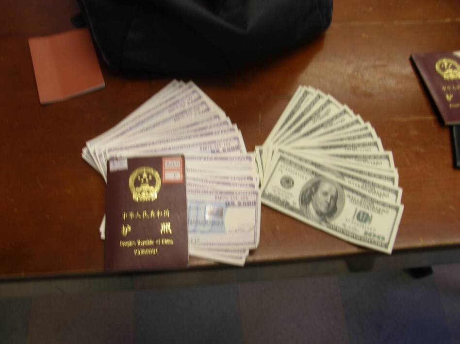 A homeless man turned in a backpack stuffed with cash and travelers checks to Boston police. A passport that was with the bag helped police find the person it belonged to.