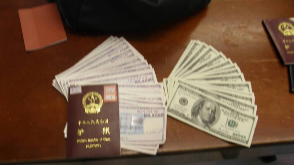 A homeless man turned in a backpack stuffed with cash and travelers checks to Boston police. A passport that was with the bag helped police find the person it belonged to. (Boston Police)