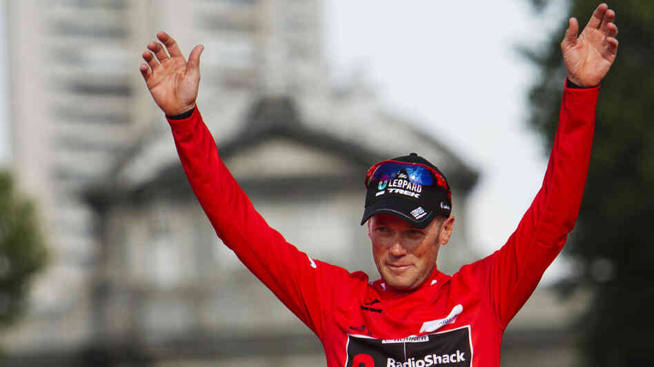 American cyclist Chris Horner celebrates winning Spain's Vuelta bicycle race Sunday. Anti-doping officials say that Horner, who at 41 is the oldest ever to win one of cycling's top events, was not at the hotel drug testers visited.