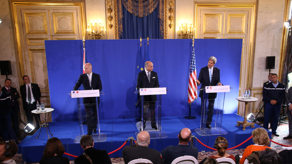 "Secretary of State John Kerry discusses the U.S.-Russia plan to eliminate Syria's chemical weapons with top British diplomat William Hague (left) and French diplomat Laurent Fabius, on Monday. Former weapons inspector David Kay says the plan includes ""unrealistic"" deadlines. (AFP/Getty Images)"