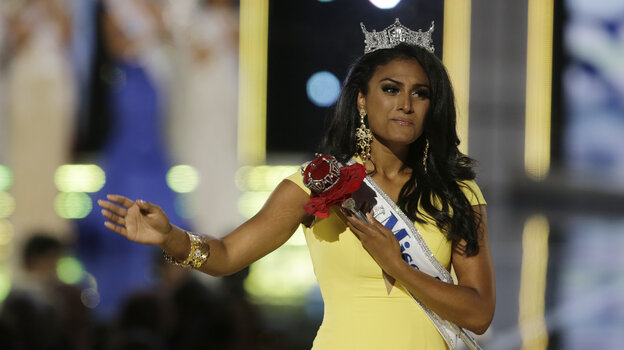 Miss New York, Nina Davuluri, walks down the runway after winning the the Miss America 2014 pageant on Sunday in Atlantic City, N.J.