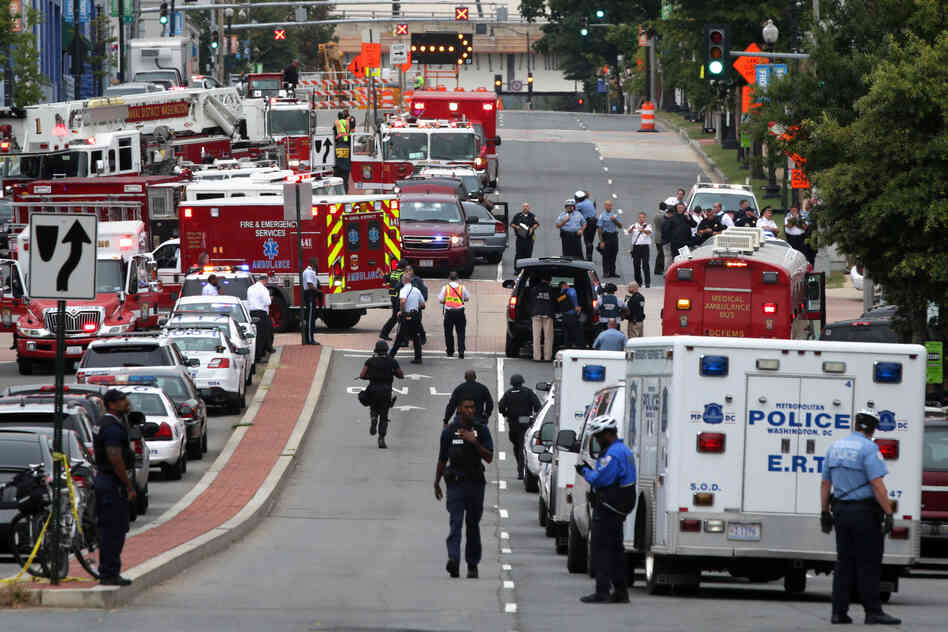 Emergency vehicles and law enforcement personnel respond to the shooting.