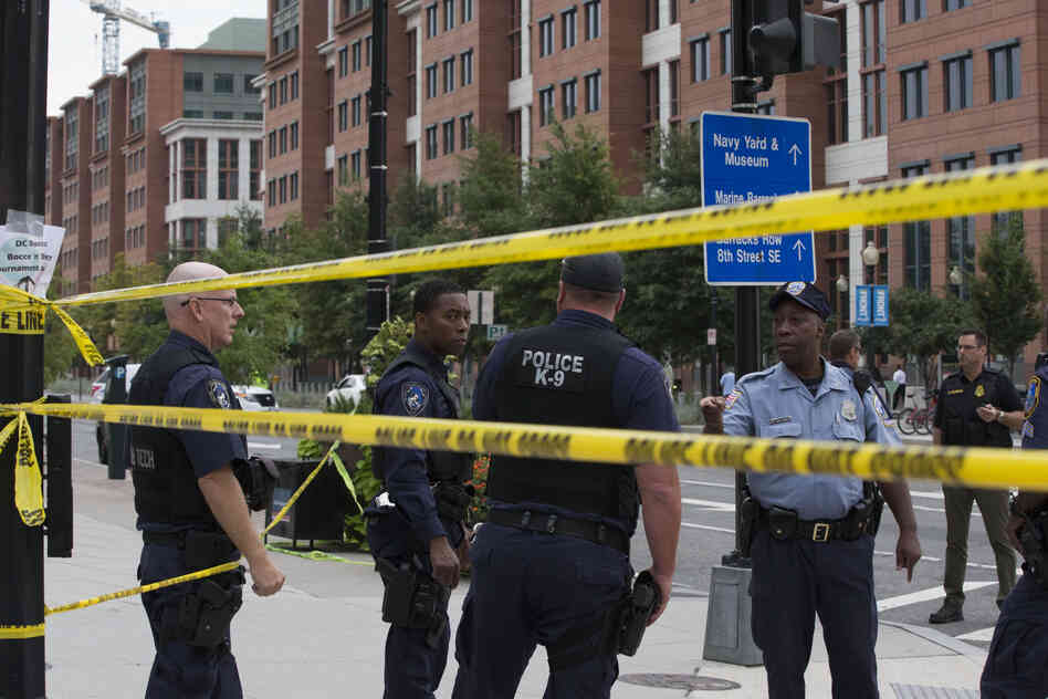Police monitor the area near the Navy Yard.