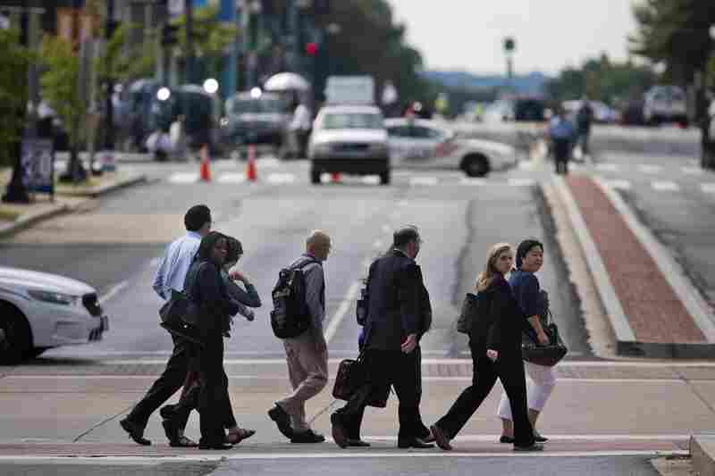 Office workers, who had been under lock down since the shootings this morning, leave the area around the Washington Navy Yard on Monday in Washington, D.C. Thirteen people were killed, including the suspected gunman, and several were wounded.