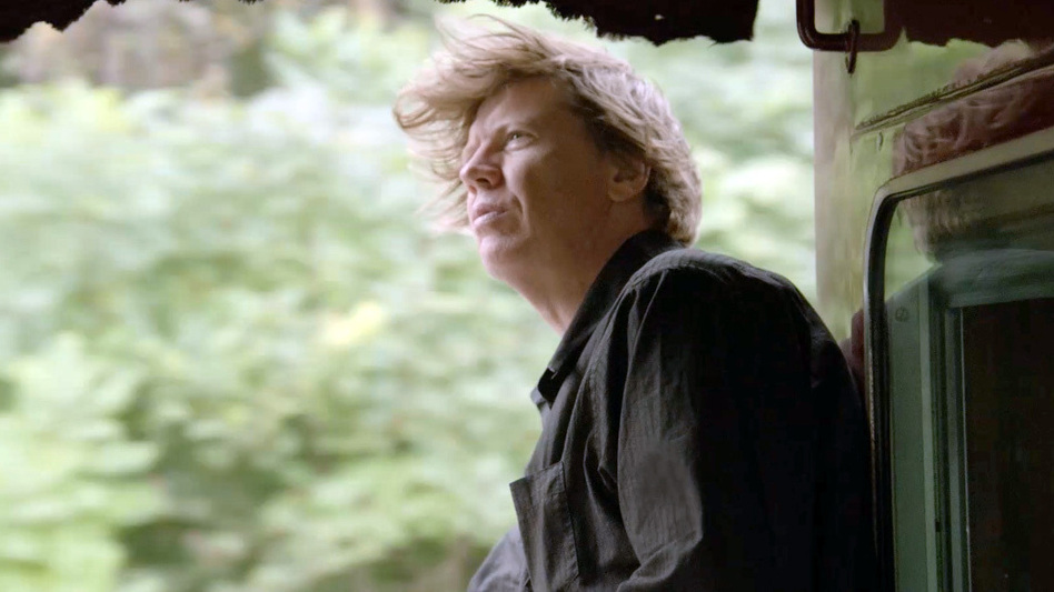 Sonic Youth's Thurston Moore gazes over the rail on the Station to Station train as it speeds across the country. (Mara McKevitt)