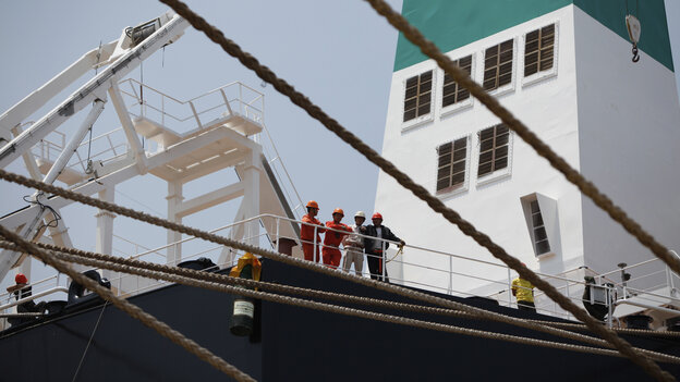 Laborers stand on a new ship at a Rongsheng Heavy Industries shipyard in Nantong, China, in 2012. The troubles at Rongsheng, China's largest private shipbuilder, mirror what's happening in the global industry.