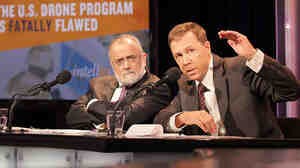 "John Kael Weston (right) and Ahmed Rashid argue in favor of the motion, ""The U.S. Drone Program Is Fatally Flawed."""