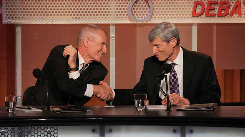 "Adm. Dennis Blair (left) and Gen. Norton Schwartz argue against the motion, ""The U.S. Drone Program Is Fatally Flawed"" in an Oxford-style debate hosted by Intelligence Squared U.S."