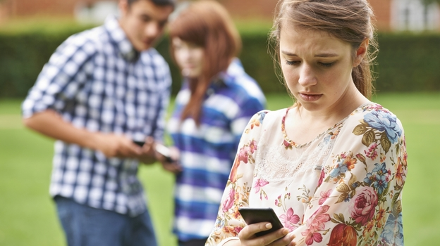 Cyberbullies can reach victims around the clock – before school, during school, even while lying in bed at night. And in public online spaces, everybody else finds out about it. (iStockphoto.com)
