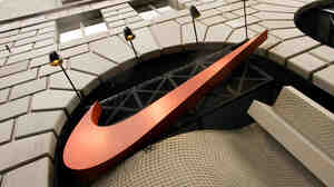 The Nike swoosh logo graces the front of the Niketown store in downtown Portland, Ore.