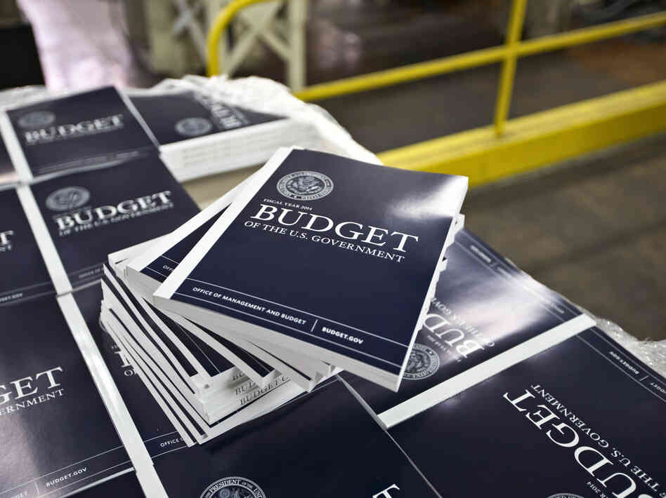 Copies of President Obama's proposed budget plan for fiscal year 2014 are prepared for delivery at