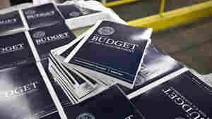 Copies of President Obama's proposed budget plan for fiscal year 2014 are prepared for delivery at the U.S. Government Printing Office in Washington in April 2013.