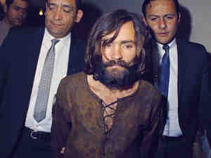 Charles Manson is escorted to his arraignment on conspiracy and murder charges in 1969.