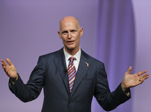 Florida Gov. Rick Scott has questioned efforts to use federally funded navigators to help people enroll for insurance through the Affordable Care Act.
