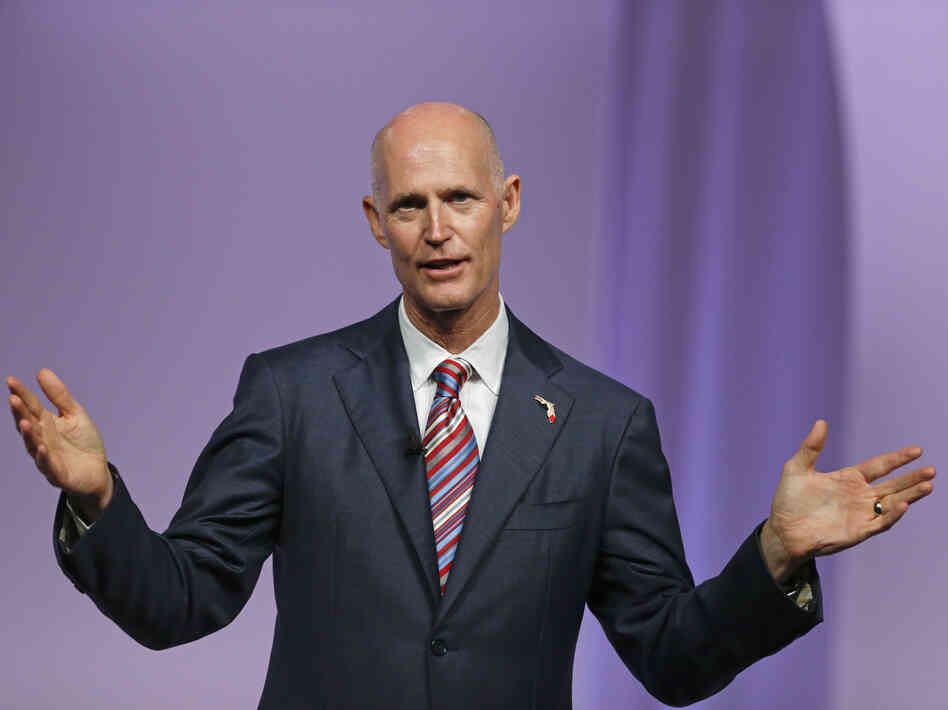 Florida Gov. Rick Scott has questioned efforts to use federally funded navigators to help people enroll for insurance through the Affordable