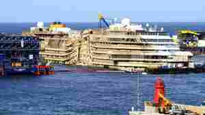 The wrecked cruise ship Costa Concordia, now back in an upright position.
