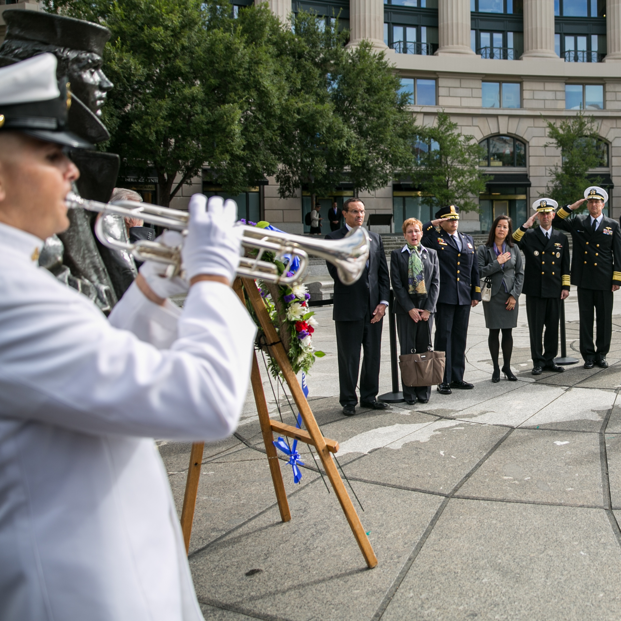 One day after 12 people and an alleged gunman died at the Navy Yard in Washington, D.C., details about their lives are beginning to emerge. On Tuesday, Defense Secretary Chuck Hagel (far right) attends a wreath-laying ceremony at the U.S. Navy Memorial in honor of the victims.